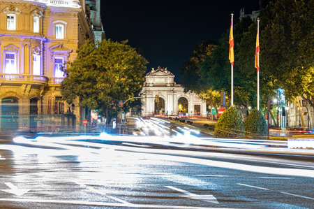 Madrid, Spain; 06/08/2020: Night picture of Puerta de Alcala with traffic in Madrid, Spain Publikacyjne