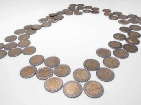 Six columns of two euro coins arranged in a pyramid shape on a white background
