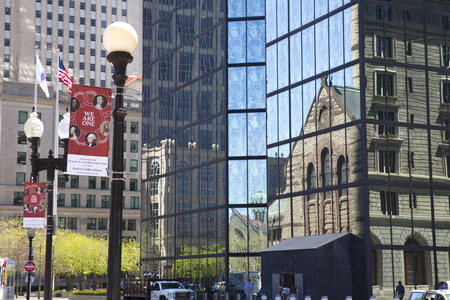 john hancock: Trinity Church reflecting on John Hancock tower in Copley Square Boston Editorial