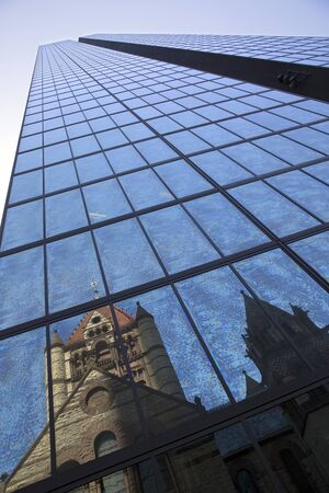 john hancock: Trinity Church reflecting on John Hancock tower in Copley Square Boston Stock Photo