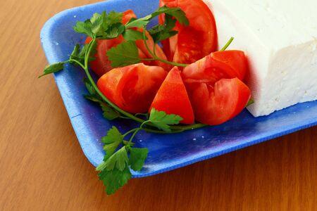 Tomatos and greek feta (cheese) Stock Photo