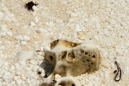 Small slice of white marble at the beach Stock Photo
