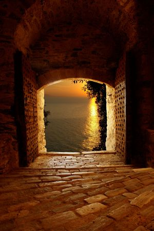 Sunset through the castle Stock Photo