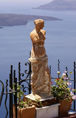Aphrodite statue on balcony (Santorini island, Greece)              Stock Photo