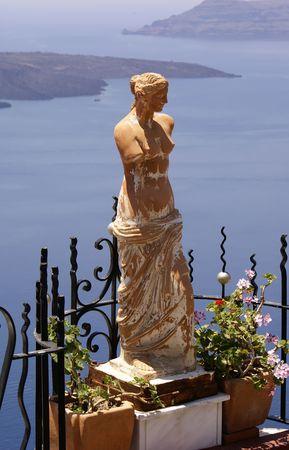 Aphrodite statue on balcony (Santorini island, Greece)              Stock Photo