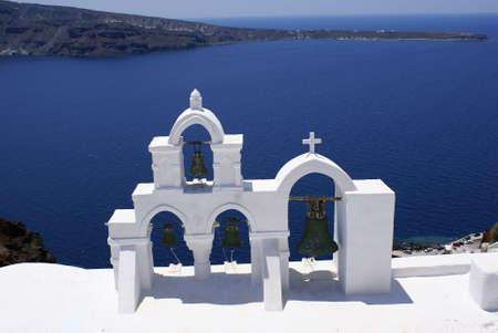 Bells of church on Santorini island, Greece Stock Photo