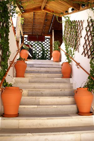 Steps to the greek taverna on terrace