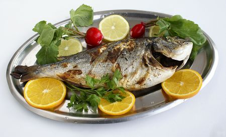 Baked fish with lemons and oranges                Stock Photo