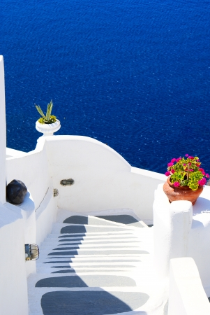 Traditional architecture of Oia village on Santorini island, Greece photo