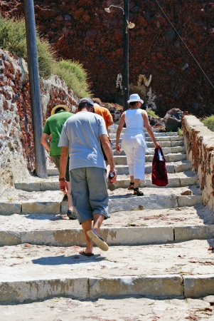 People climbing at stairs of stone photo