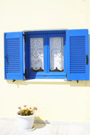 Old Greek  traditional house with blue window in Santorini island, Greece 스톡 사진