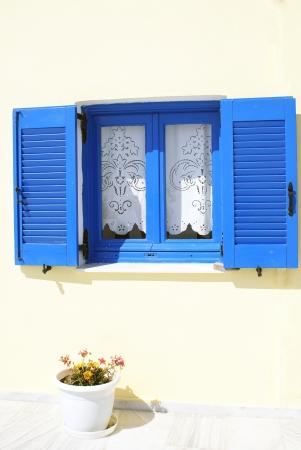 Old Greek  traditional house with blue window in Santorini island, Greece Stock Photo