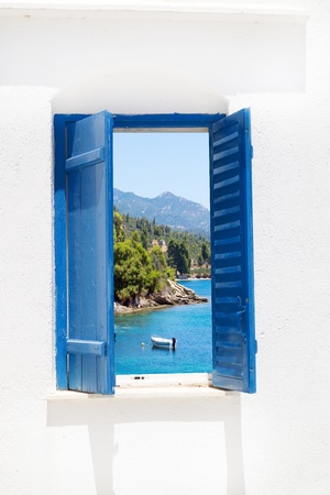 Traditional window with sea view at Halkidiki peninsula, Greece Stock Photo