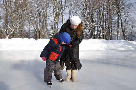 A little boy stood up for the first time on skates photo