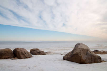 Boulders in the ice on the shore of Lake Ladoga photo