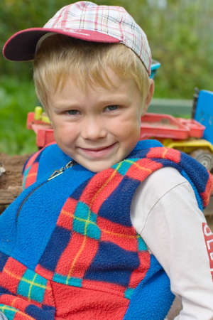 Five year old boy playing in a sandbox photo