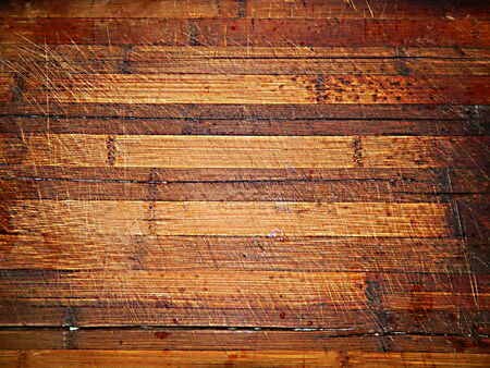 durable: Old cutting board made of small light and dark boards of the kitchen table, solid wood, durable.