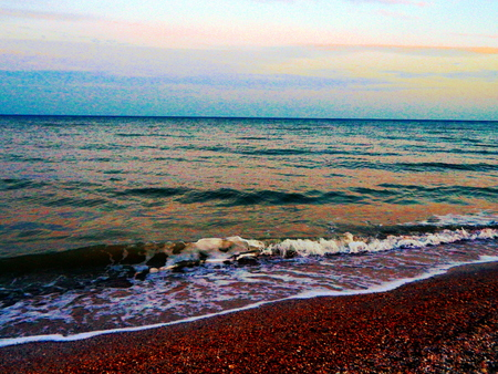at sea in summer Ukraine waves and shore at the end of summer on the Azov Sea