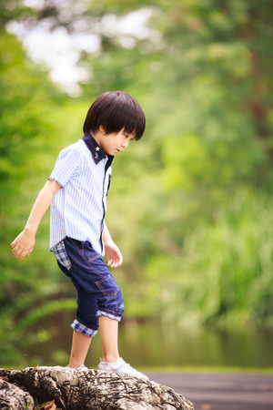 asian family home: boy on the rock Stock Photo