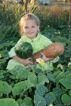 Girl cleans pumpkin in the country