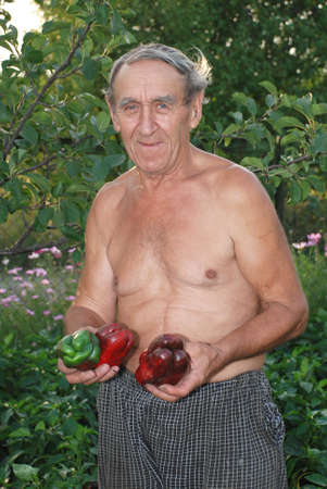 Man in the country with pepper in hands Stock Photo - 18426038