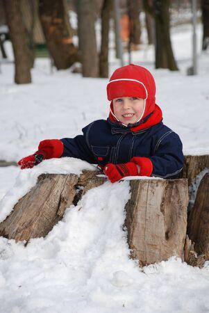 The boy in the winter sitting inside hemp Stock Photo - 18496225