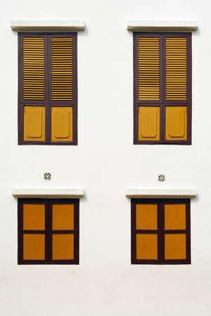 Yellow Wood Windows on white wall photo