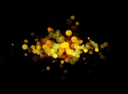 luminescence: Luminescence in the dark, a background with yellow fires. Effect bokeh