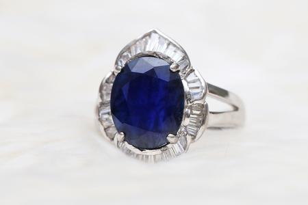 Blue gemstone on silver ring Stock Photo