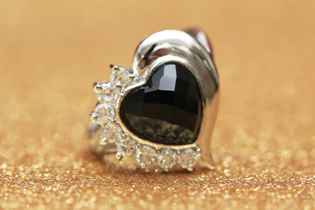 diamond ring and black gemstone Foto de archivo