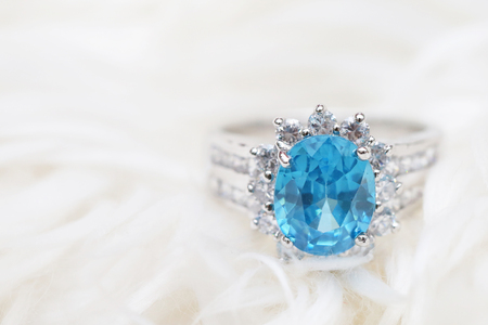 diamond ring and blue gemstone Stock Photo