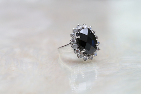 jasper black gemstone on diamond ring Stock Photo