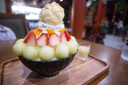 Bingsu topped with milk and mixed fruit With vanilla ice cream