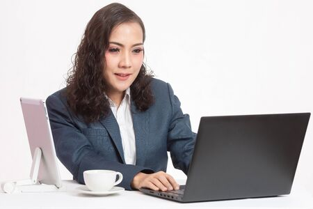 Beautiful young executive with her work and coffee
