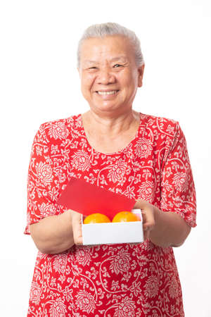 Old woman and Chinese new year. Imagens