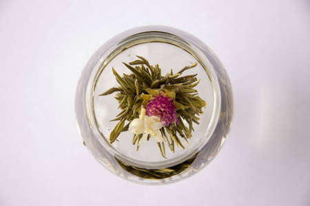 A glass of artisan blooming tea Stock Photo - 670442