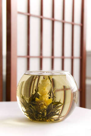 A glass of artisan blooming tea photo
