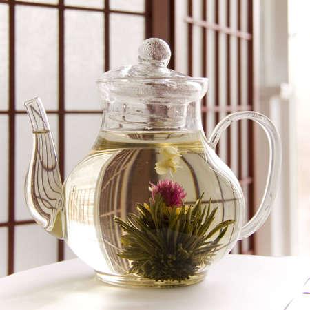 highend: A teapot of artisan blooming tea Stock Photo