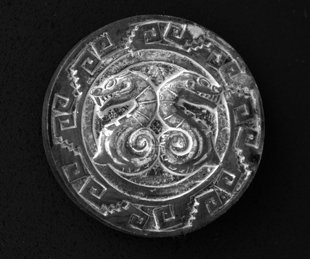 Fridge Magnet of black color on black background, with snakes of Ancient religious symbol Mayan Stock Photo - 16838297