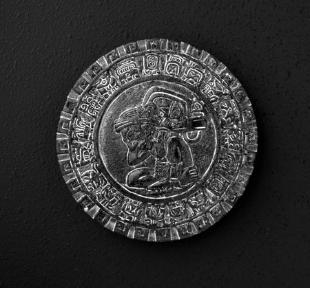 Fridge Magnet of black color on black background, with the motive of Ancient religious symbol Mayan Stock Photo - 16838289