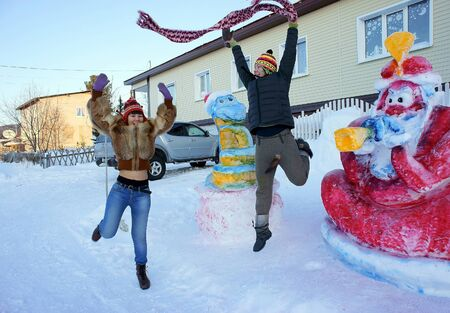 Girls jumping around the house in winter  photo