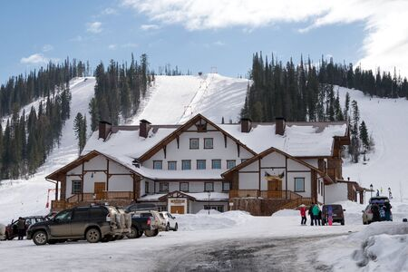 Beautiful building on the background of the ski slope.