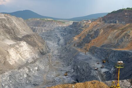 Nepheline open-cut ore mine during the work shift from above.