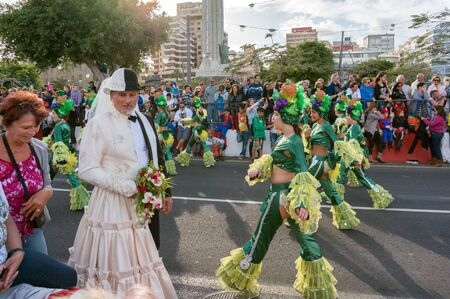 Santa Cruz de Tenerife. Spain.A man in a double suit of the bride and groom on the background of the festive procession.