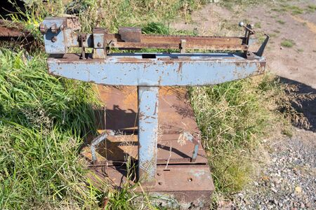Old Soviet mechanical freight scales stand on the grass in summer. Stock Photo