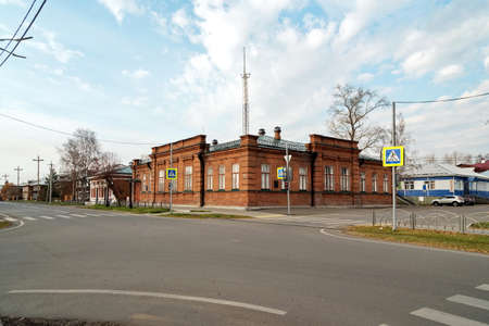 The historical brick building of Balandin's reading room, now the registry office in the city of Yeniseysk, Krasnoyarsk region of Russia. View from Lenin Street.