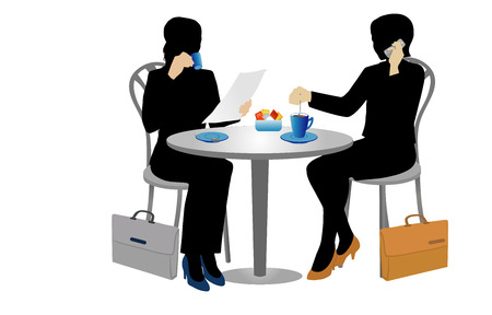 Two businesswomen at a table drinking coffee.