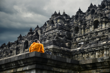 Buddhist monk praying at Borobudur Temple, Yogyakarta