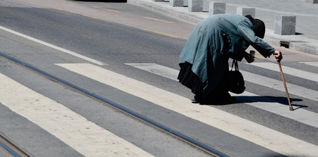 pity: An old woman crossing street
