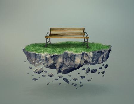 Lege houten bank op een stenige gras begroeide eiland zweven en desintegreren in de lucht met schaduw en kopie ruimte op een grijze surrealistische concept van de eenzaamheid en milieu Stockfoto